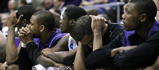 Kansas  State players, including Jacob Pullen, center, sit on the bench during the final minute of the NCAA West Regional final college basketball game against Butler in Salt Lake City on Saturday. Butler beat Kansas State 63-54.