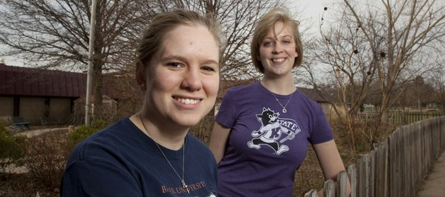Education majors Avaree McDonald, a senior at Baker University from Beloit, front, and Megan Lutz, Kansas State junior from Topeka, pictured Friday at Deerfield School, will lead more than 80 college students volunteering with landscaping and other projects at four Lawrence elementary schools today. The future teachers are in town for a conference with the Kansas National Education Association.