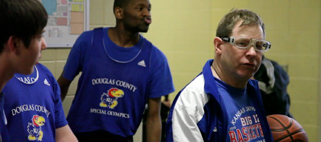 "Todd Williams, right, always takes a leadership role in his involvement of Special Olympics. He is known as ""Leaper"" to his teammates and most who know him well in Lawrence and Kansas University, where he has worked for 40 years."