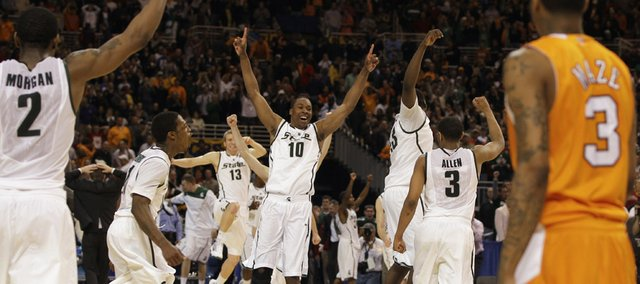 Michigan State players celebrate after their 70-69 win over Tennessee in the NCAA Midwest Regional championship game Sunday, March 28, 2010, in St. Louis.