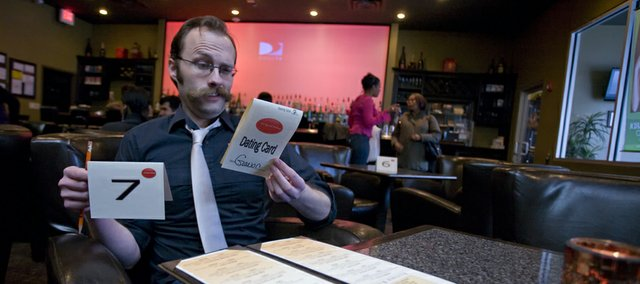 Journal-World staff writer Gavon Laessig preps for his speed-dating experience at  Qudos Cigar & Cognac Bar in Kansas City, Mo.
