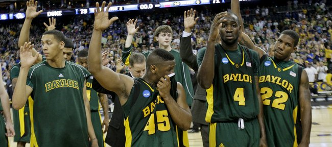 Members of the Baylor basketball team wave to fans as they walk off the court following the South Regional final. The Bears fell to Duke, 78-71, on Sunday in Houston.