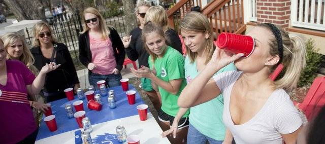 Kansas University students participate in a beer drinking game in March 2010 outside a student rental house just off campus.