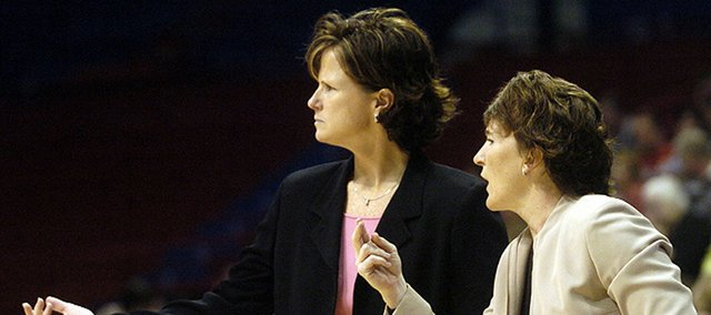 Kansas coach Bonnie Henrickson, left, and assistant coach Karen Lange provide instruction in this file photo from 2005. Lange was announced as the new coach at Mid America Nazarene on Tuesday.