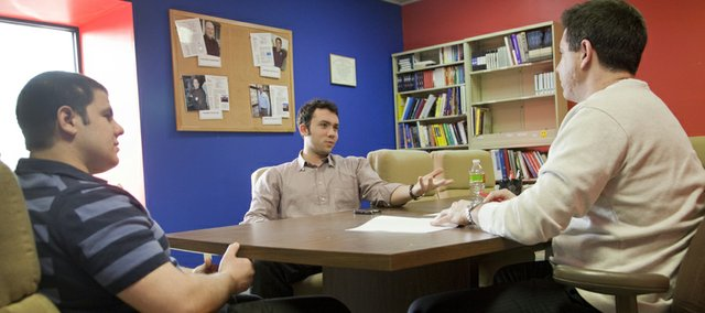 Kansas University sophomores Justin Sharkan, left, and Jason Mandel, center, both from Chicago, visit with Will Katz, regional director of the KU Small Business Development Center, about starting their own business. Katz advises people on how to find money to start their business, how to write a business plan, how to market a business and many other facets of business.