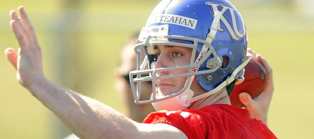 Conner Teahan turns to throw as he works out with the quarterbacks during the Jayhawks' practice Wednesday.