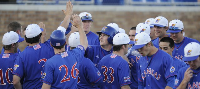 The Jayhawks celebrate during their victory against Missouri State on Wednesday at Hoglund Ballpark. Kansas won the game 7-6.