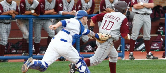 Kansas University catcher James Stanfield tags out Texas A&M baserunner Kevin Gonzalez (10) after he got caught trying to score on a double steal. KU won, 9-5, on Thursday at Hoglund Ballpark.