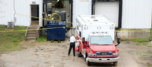 Division Chief Rich Barr investigates the scene at MagnaGro International, 600 E. 22nd St., on Friday, April 2, 2010, a day after two workers died there in an industrial accident.