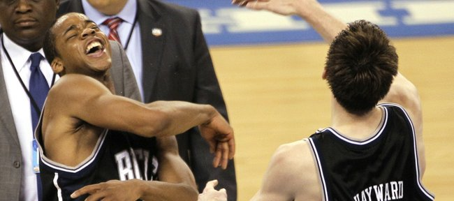 Butler players Ronald Nored (5) and Butler's Gordon Hayward (20) celebrate after their 52-50 win over Michigan State in a men's NCAA Final Four semifinal college basketball game Saturday, April 3, 2010, in Indianapolis.