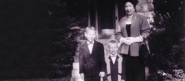 Bob Flannery, left, Joe Flannery and Dorothy Flannery in front of 2325 Mass., circa 1955.