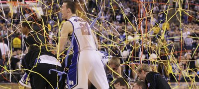 Duke's Miles Plumlee (21) and teammates celebrate after Duke's 61-59 win over Butler in the men's NCAA Final Four college basketball championship game Monday, April 5, 2010, in Indianapolis.