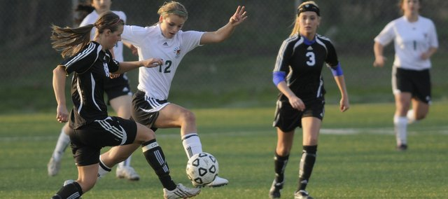 Free State forward Abbey Casady competes for control with Olathe Northwest defender Lauren Reiman. The Firebirds lost, 2-0, Thursday at Free State High.