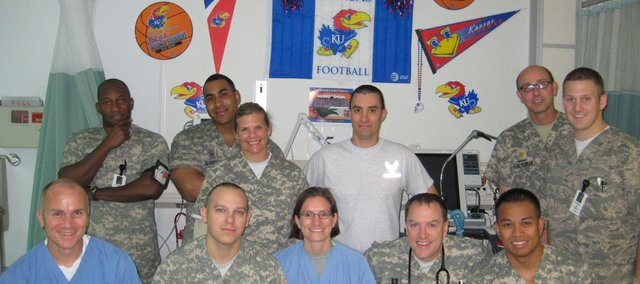 "The designated ""KU ICU bed"" is in full display at an armed services hospital at Bagram Air Field in Afghanistan. KU geography professor Jerry Dobson's daughter-in-law, Nicole Dobson, pictured, was serving as a doctor there when the hospital was seeking memorabilia from national universities to display in the hospital."