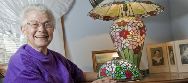 Frieda Culbertson  has been creating stained-glass artwork for 20 years. She works in a basement studio, cutting and soldering multiple pieces of colorful glass into lamps, windows and other decorative pieces.