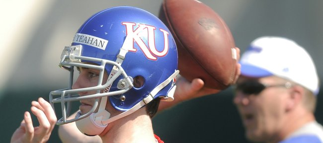 Conner Teahan turns to throw as he works out with the quarterbacks during the Jayhawks' practice in this file photo from March 31 at the KU practice fields.
