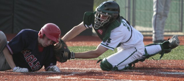 Free State catcher Adam Petz saves a run by tagging out Olathe North runner Connor Dawson during the second inning, Monday, April 12, 2010.