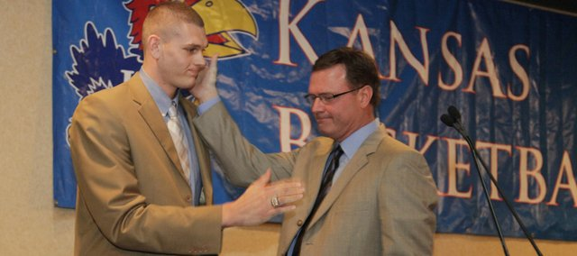 Kansas junior Cole Aldrich, left, is congratulated by coach Bill Self after Aldrich and Sherron Collins were named co-winners of the Danny Manning/Mr. Jayhawk award at the KU mens basketball banquet. Aldrich is trying to decide what he&#39;ll wear for the cameras during the NBA draft Thursday.