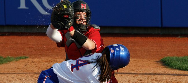 The Nebraska catcher shows the ball after blocking Kansas baserunner Sara Ramirez from the plate during the game Wednesday, April 14, 2010, at Arrocha Ballpark.  Ramirez was called out on the play. The Jayhawks lost 2-0 to the 'Huskers and fell to 1-8 in Big 12 Conference play.