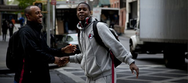 Kansas recruit Josh Selby of Baltimore, right, slaps hands with ESPN analyst Jay Williams before getting on the bus after practice Friday, April 16, 2010, at The Sports Club/LA in New York City. Selby will play for the West team in the Jordan Brand Classic on Saturday night at Madison Square Garden in New York.