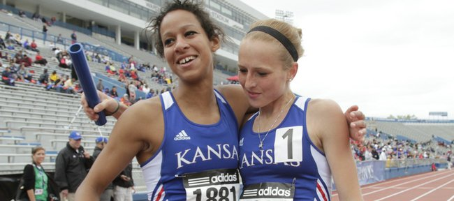 Kansas runners Lauren Bonds, left, hugs teammate Rebeka Stowe after they won the distance medley relay. The team won the Kansas Relays race in 12:00.70 on Friday at Memorial Stadium.