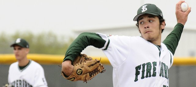 Free State pitcher Cody Kukuk winds up to throw against Raymore-Peculiar (Mo.). Kukuk pitched a complete-game shutout on Friday at the River City Festival at Free State High.