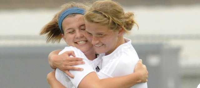 Free State's Hillary Yoder, left, and Chelsea Casady celebrate Yoder's soccer goal against Shawnee Mission Northwest. The Firebirds won, 2-0, on Tuesday at Free State High.