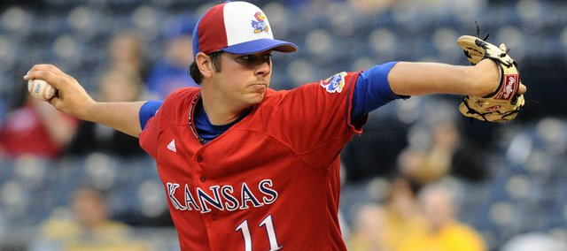 KU freshman starting pitcher Thomas Taylor winds up Wednesday, April 21, 2010 as Kansas and Missouri met for their annual border showdown at Kauffman Stadium. The Jayhawks took home bragging rights after a 1-0 victory.