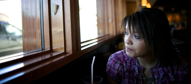 Jenny Ray McGee, a 20-year-old Lawrence High school graduate, crying, stares out of a California Pizza Kitchen restaurant window Jan. 26, the morning of a doctor's appointment at Children's Mercy Hospital in Kansas City, Mo. Jenny Ray, who has an undiagnosed genetic condition, was to get lab results back at the hospital, and she hoped she would finally find out what is causing the sickness in her body.