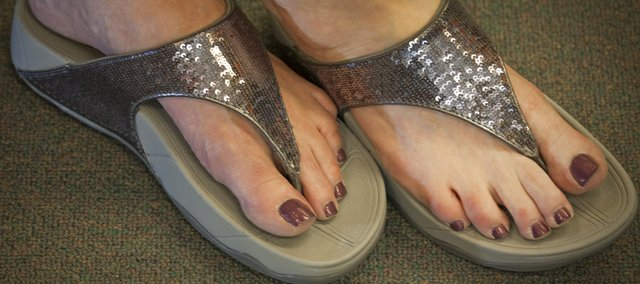 Fitness women's sandals with a little bling on top from Brown's Shoe Fit, 829 Mass. New shoes on the market tout health benefits, whether easing back pain or toning leg muscles.