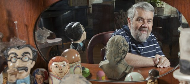 Baseball was Bill James hobby until he made a name for himself in the baseball world by analyzing players and statistics to project likely future results. One new hobby that replaced baseball was an interest in collecting sculptures and facsimiles of real people. James is pictured at his Lawrence home.