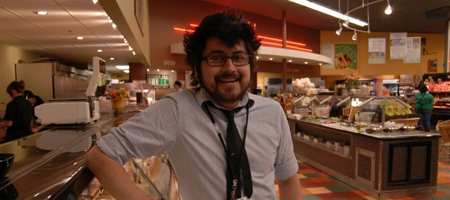 Miguel Luevano is the deli counter manager at Community Mercantile, 901 Iowa. He says he enjoys the benefits of flex time.