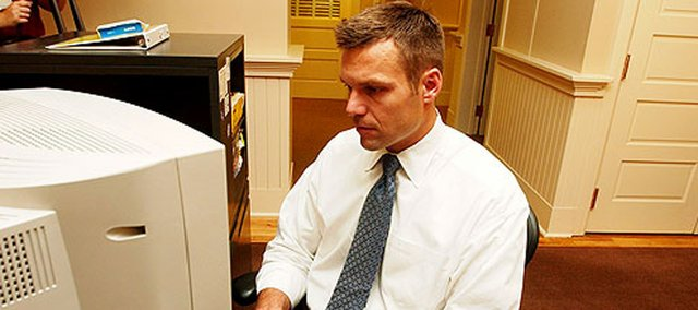 Kris Kobach engages in an online chat with ljworld.com readers in this 2004 photo. Kobach helped write a new immigration law in Arizona that has civil rights groups up in arms.