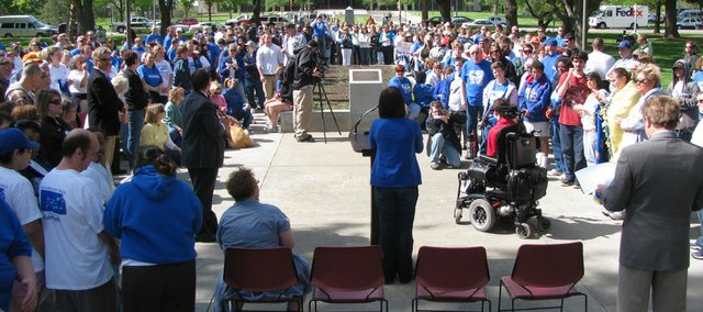Several hundred people on Wednesday attend rally on the south lawn of the Capitol in support of funding for programs for Kansans with disabilities. The event occurred on the first day of the Legislature's wrap up session.
