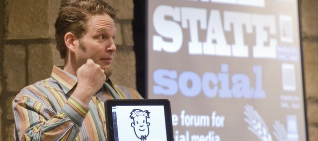 "Chris Brogan, author of ""Social Media 101,"" kicks off the Free State Social gathering by introducing himself in cartoon form on his iPad. Brogan, president of New Marketing Labs, was the keynote speaker at the social media conference Thursday at The Oread hotel."