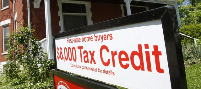 A sign promoting the $8,000 tax credit for first-time homebuyers is posted outside a home for sale Wednesday in Cincinnati. The tax credits expire at midnight today.