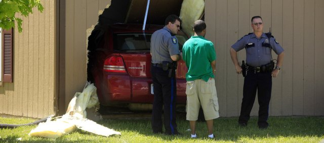 Lawrence police respond after a man suffered a medical condition and ran his car into a building shortly after noon on Tuesday, May 4, 2010.