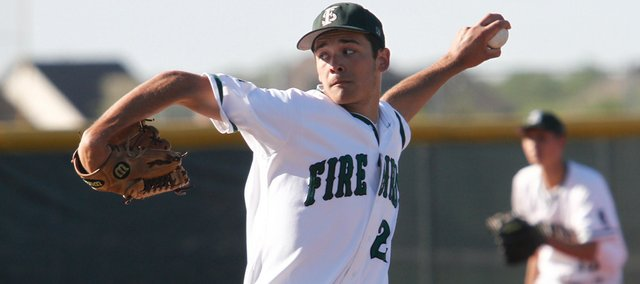 Free State's Cody Kukuk delivers a pitch during the game against Olathe South on Tuesday, May 4, 2010, at FSHS. Free State won the game 8-5.