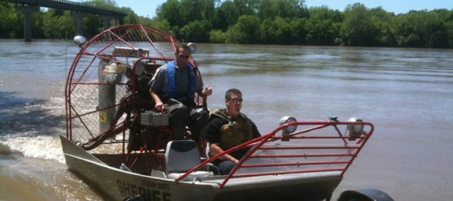 Officials with the Jefferson County sheriff's department and the Kansas Department of Wildlife and Parks participated in a search Wednesday for a suspect on the Kansas River. The man was apprehended about 12:30 p.m., and was taken into custody by Shawnee County sheriff's officers.