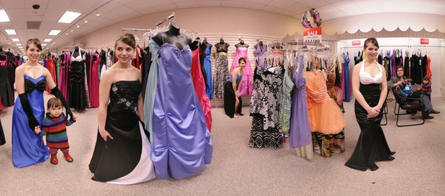 This 360-degree photograph consists of six, wide-angle photographs stitched together in a panorama software program. Viewed online the 360-degree image becomes an interactive virtual reality Quicktime movie (QTVR). The individual photos of Kattia Andrews, a junior at Marmaton Valley High School, shows her wearing six prom dresses at Weaver's Department store in March.