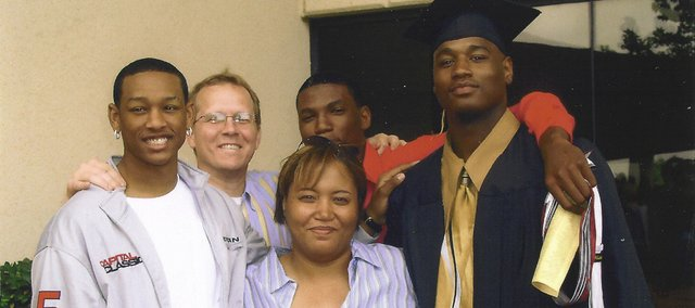 Former Kansas University forward Darnell Jackson, far right, poses for a high school graduation photo in 2004 in Oklahoma City with his late mother, Shawn (middle), brother Evan (behind), family friend Don Davis (behind left) and former KU basketball player and fellow Oklahoman J.R. Giddens. Jackson recently spoke openly regarding the death of his mother, which occurred a little more than a month ago.