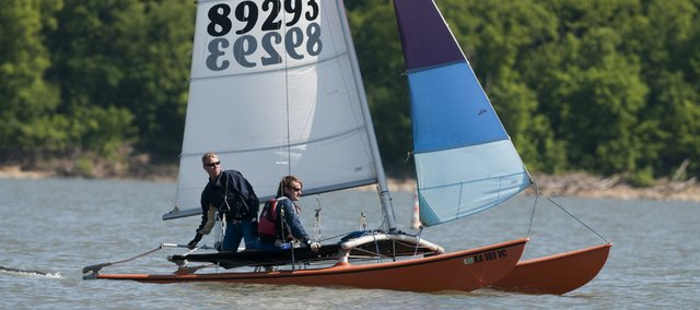 Scott Dalin and Evan Charles, both from Lawrence, participate Saturday in the third annual Frayed Knot Regatta at Clinton Lake.