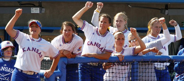 The Kansas bench tries to cheer on a rally from the dugout. KU split a doubleheader with Iowa State, winning 3-0 and losing 4-3, on Saturday at Arrocha Ballpark.