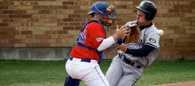 Kansas catcher James Stanfield blocks home plate while catching a throw to home during Sunday's game against Missouri May 9, 2010.