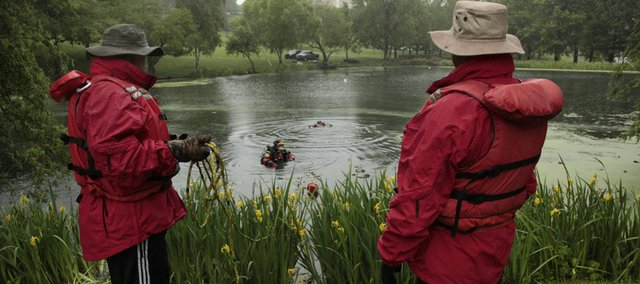 Lawrence law enforcement personnel took advantage of Potter Lake on the Kansas University campus for some underwater training on Monday.
