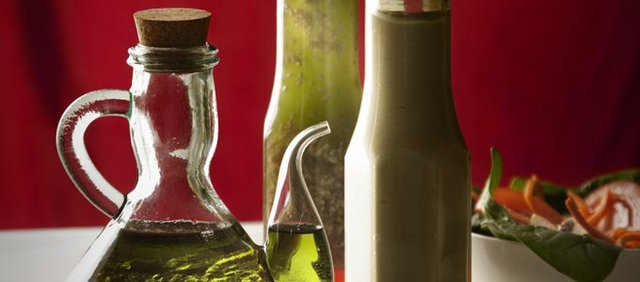 Red wine vinegar with grapeseed oil, left, raspberry sesame dressing and avocado dressing.