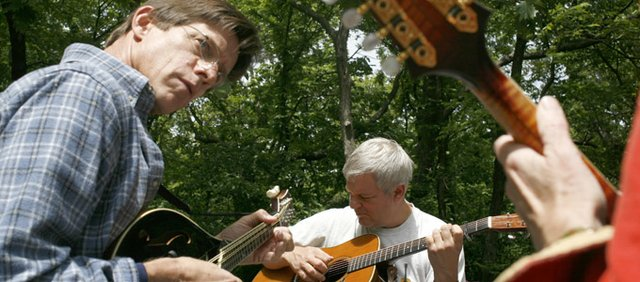 Mark Chambers, left, and Dave Gustafson, center jam out during the Third Annual Stringband Rendezvous in 2006.