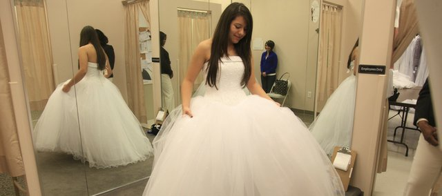 Weeks before the Quinceañera, Alia Eryn Zilliox tries on her dress in Topeka.