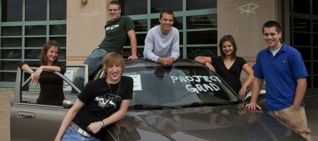 Project Graduation is awarding a car to a senior from a Lawrence high school. Some of the graduating seniors from the four area high schools are, clockwise from front left, Pete Esau, Bishop Seabury Academy; Sarah Hanson, Free State; Sam Callan, Free State; Chase Billings, Lawrence High; Carlin Francis, LHS; and Joshua Barclay, Veritas Christian School.