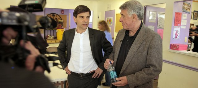 "George Stephanopoulos, ""Good Morning America"" anchor, left, meets with Lawrence Community Shelter Director Loring Henderson on May 11 in Lawrence for a segment about mentors that will appeared on the ABC show Wednesday morning. The two met 30 years ago while working in Washington, D.C."